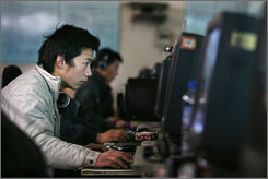 Chinese Internet users go online earlier this month at a Beijing shop. A new grass-roots movement is underway in which technogeeks, Internet addicts, Blackberry owners and compulsive instant-message users hope to wrest back control of their lives by daring to switch off  if only for a day.