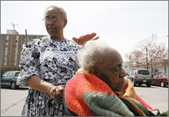 Connie Mitchell pushes her mother Florence Mitchell, 89, outside Kenton Healthcare, a nursing home in Lexington, Ky., which is displacing about 120 residents because the facility failed to respond to state inspectors' citations. Life expectancies are shorter in Appalachia and the Deep South, research finds.