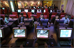 People use computers inside an Internet cafe in Xining, northwestern China's Qinghai province, in November 2006.