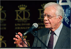 Former President Jimmy Carter gives a speech in Jerusalem on Monday after talks in Syria and Egypt with Hamas leaders.