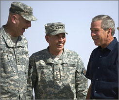 Gen. David Petraeus (center) and Lt. Gen. Raymond Odierno (left) greet President Bush as he arrives at Al-Asad Air Base in Anbar Province, Iraq, in this Sept. 2007, file photo.