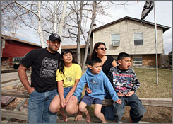 Staff Sgt. Daniel Escamilla, who managed to save his home from foreclosure recently, hunkers down with wife Angie and their kids: Marissa, 10; Rocky, 5, center; and Daniel, 8.