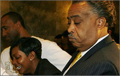 Nicole Paultre Bell, center, leaves the courtroom in tears with the Rev. Al Sharpton, right, Friday at the State Supreme Court in the Queens borough of New York.
