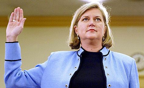 Sherron Watkins is sworn in before members of a House committee in February 2002. Watkins' whistleblowing helped reveal the Enron scandal in 2001.