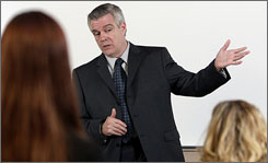 Dave Welch, who was fired from his accounting job at a tiny Virginia bank after blowing the whistle on their questionable bookkeeping and stock trading practices, answers questions during presentation to Franklin University students in Columbus, Ohio.