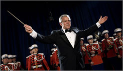 "President Bush turns to the audience after conducting the United States Marine Corps Band, known as ""The President's Own,"" during the annual dinner of the White House Correspondents' Association on Saturday."