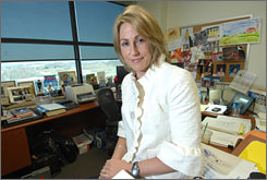 Heather Bresch, chief operating officer of Mylan Pharmacueticals, sits in her office in Canonsburg, Pa., decorated mostly with artwork from her children's school activities. Bresch is in the middle of a controversy over her executive MBA from West Virginia University.