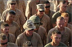 Marines from the 24th Marine Expeditionary Unit listen to their commanding officer as they prepare to leave in convoy from a forward operating base in southern Afghanistan on Monday.