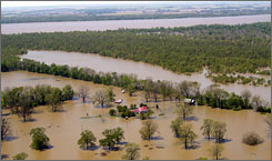 This aerial photograph taken April 16, 2008, near Vicksburg, Miss., shows the extensive nature of the flooding from the Mississippi River, background, and its tributaries. The muddy Mississippi is at levels not seen in more than three decades, putting hundreds of thousands of acres of farmland under water.
