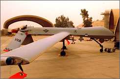An AGM-114 Hellfire missile is unloaded from an MQ-1 Predator unmanned aerial vehicle after a mission in May at Balad Air Base, Iraq in this undated image.