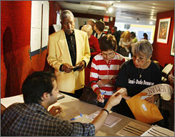 Florida residents sign in to vote for delegates to attend the Democratic National Convention at a voting station in The Roxy Theatre in Miami on March 1. Florida requires the use of photo ID to vote.
