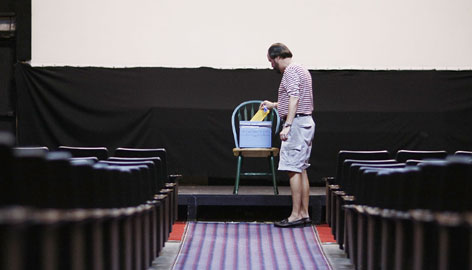 Jeffrey Dorn drops his selection into the ballot box for his choice of delegates to attend the Democratic National Convention at a voting station in The Roxy Theatre in Miami on March 1.