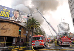 Los Angeles City firefighters battle a stubborn fire at a nightclub at the famous intersecton of Hollywood and Vine in Los Angeles on Wednesday.