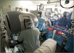 Cardiac surgeon Sudhir Srivastava manipulates a robot's arms to perform a bypass at the University of Chicago Medical Center.