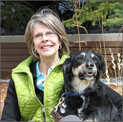 Reporter Sharon L. Peters sits with her dog Jasper.