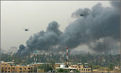U.S. helicopters fly over smoke rising from a mortar attack March 27 in the Green Zone area of Baghdad.