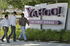Yahoo workers walk in front of Yahoo headquarters in Sunnyvale, Calif.