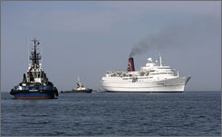 Latvia's coast guard vessels approach the stranded cruise ship Mona Lisa.