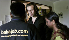 Babajob Services Private Ltd. Chief Executive Officer Sean Olin Blagsvedt, center, talks to his colleagues at his company's headquarters in Bangalore, India.