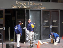 The FBI says no one was hurt when a suspected pipe bomb damaged the Edward J. Schwartz federal courthouse in San Diego on Sunday.