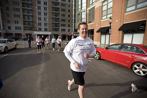 Randy Eilering, 29, joins up with fellow runners at the start of a five-mile evening run in Arlington Heights, Ill. He started exercising at age 25 and has lost about 100 pounds.