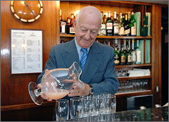 Arrigo Cipriani, owner of Harry's Bar, pours the bar's famous Bellini drink in his bar in Venice, Italy. The bar is giving a 20% discount to U.S. tourists during the duration of the sub-prime loan crisis.