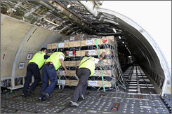 Supplies from around the world, such as these being loaded onto a plane in Brindisi, Italy, are being shipped to Burma.