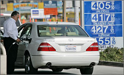 Gas prices have risen well above the $4 a gallon mark, in Half Moon Bay, Calif. Record high gas prices are prompting Americans to drive less for the first time in nearly three decades, squeezing family budgets and causing major shifts in driving habits.