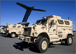 Mine-resistant, ambush-protected vehicles (MRAP), produced by Navistar International, are loaded onto an airplane at the Charleston Air Force Base in North Charleston, S.C. Nov. 28, 2007.
