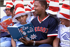 "Boston Red Sox pitcher Pedro Martinez reads The Cat in The Hat to students in Fort Myers, Fla. Did Dr. Seuss write books to be fun for kids, or is The Cat in the Hat really the Christ who arrives with a ""BUMP""  and turns the world upside down for God's children?"