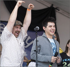 American Idol contestant David Archuleta, and his father, Jeff Archuleta, celebrate before a performance at David's high school Friday in Murray, Utah.