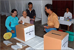 Several people vote at a polling station in Burma on Saturday. Polling stations opened in parts of cyclone-hit Burma, as the military regime asked voters to approve a new constitution just one week after thousands of people died in the storm.