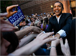Democratic presidential hopeful Barack Obama greets the crowd at a rally at the University of Oregon in Eugene on Friday.