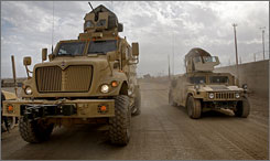 Army troops return to base following patrols in the neighborhoods of Dora on the outskirts of Baghdad Dec. 4, 2007.