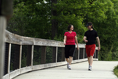 Heather Burczynski walks with her friend Rob Brooks in Nashville She used to weigh 280 pounds, but now she exercises an hour a day, six days a week.