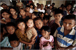Burmese children wait for relief supplies on Wednesday in Kyauktan, Burma, while the country braces for yet a second cyclone.