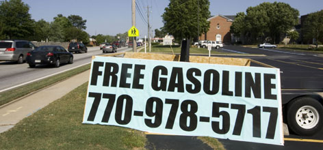 A sign indicating free gas and a phone number beckons motorists as they pass First Baptist Church in Snellville, Ga. The church is raffling two $500 tickets for free gas with the intentions of drawing people to revival services as well as making an effort to serve the community with the gesture.