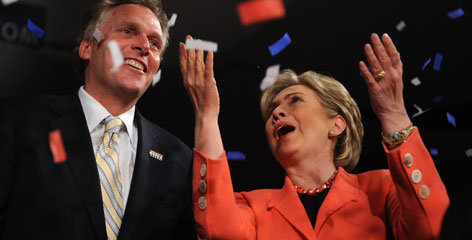 Democratic presidential hopeful New York Senator Hillary Rodham Clinton and campaign chairman Terry McAuliffe celebrate her primary win at the Charleston Civic Center in Charleston, W.Va., Tuesday.