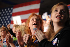 Supporters of Democratic presidential hopeful New York Senator Hillary Rodham Clinton react as they watch election results at the Charleston Civic Center.