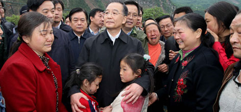 Chinese Premier Wen Jiabao consoles the families in Beichuan devastated by the worst quake disaster to strike the nation in a generation.
