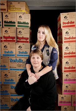 Pam Sharpe and her daughter Jennifer, 15, pose Feb. 5 with Girl Scout cookies in their Dearborn, Mich., garage.