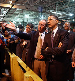 Barack Obama tours the Chrysler Motors stamping plant with Vice Chairman Jim Press, right, in Sterling Heights, Mich. May 14.