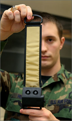 Second Lt. Brian Hunt holds up a TRON device  Target Recognition Operator Notification  a fiber optic panel that can be seen with night vision at Wright-Patterson Air Force Base in Dayton, Ohio, in Jan. 2008.