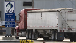 A grain trucks from central Illinois farms arrive at the Archer Daniels Midland East plant, in Decatur, Ill. ADM released its third-quarter earnings last month, showing profits rose 42%, topping analyst estimates, as it increased commodity trading and soybean crushing.