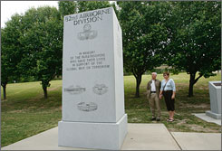 Maj. Gen. Allen Youngsman, retired, and Elisa Youngman, both of Bowling Green, Ky., visit a monument to members of the 82nd Airborne who have died in the war on terror. This monument is one of several around the country growing too small to include the mounting list of war dead.