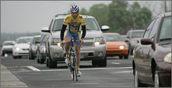 David Anderson of Double-Take Software rides his bicycle along 82nd Street in Indianapolis.