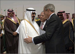 Saudi Arabia's King Abdullah welcomes President Bush upon his arrival at Riyadh-King Khaled International Airport in Riyadh.