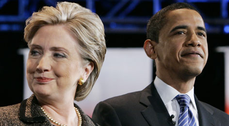 Hillary Rodham Clinton, left, and Barack Obama, right, seen here before a Feb. debate in Cleveland, faced off in two primaries tonight. Clinton won the Kentucky vote; Oregon went to Obama.