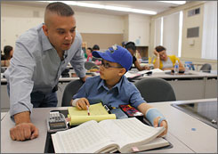 East Los Angeles College Math instructor Daniel Judge, teaches statistics to Moshe Kai Cavalin, 10, attends college classes in East Los Angeles College in Los Angeles, Calif.