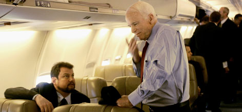 Foreign policy adviser Randy Scheunemann, left, chats with John McCain aboard the candidate's chartered plane last week.
